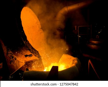 pouring molten iron from ladle