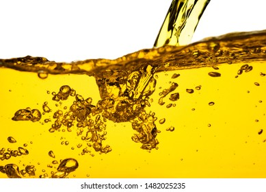 Pouring oil car motor gasoline lubricant engine or olive vegetable cooking and bubble isolated on white background