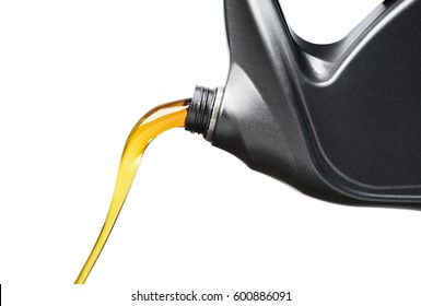 Pouring oil lubricant motor car from black bottle on isolated white background