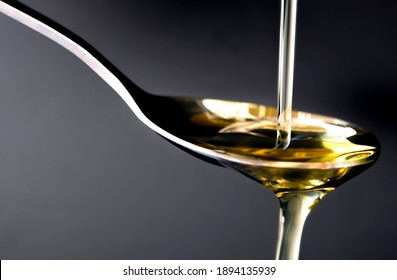 Pouring olive oil in the a spoon at kitchen. Prepare for cooking concept. Healthcare and Beauty Concept.soft focus