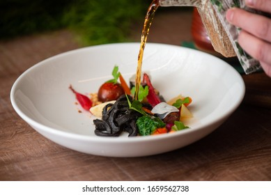 Pouring ramen soup in a restaurant