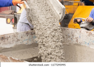 Pouring ready-mixed concrete from mixing mobile the concrete mixer into basket steel to lift the concrete to the point of inaccessibility.