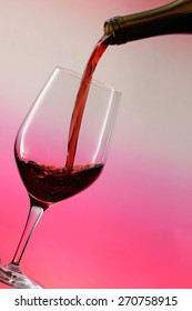 Pouring red wine / red wine bottle / red wine glass