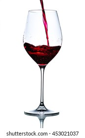 pouring red wine in glass