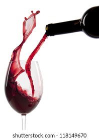 Pouring red wine in a glass isolated