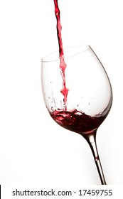 Pouring Red Wine in a Glass with White background