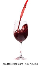 pouring red wine in goblet, isolated on white
