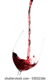 Pouring red wine into a crystal wine glass