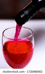 Pouring a red wine into the glass