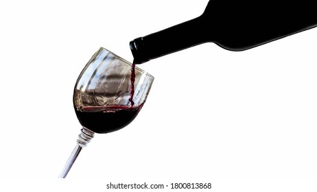 Pouring red wine into a wine glass,isolated on white background,close-up