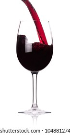 Pouring red wine into the goblet on a white background