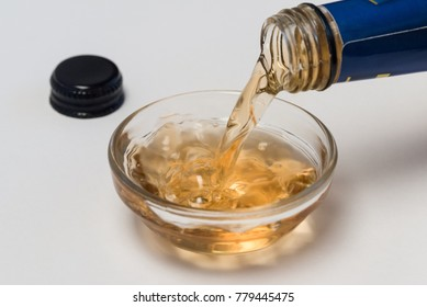 Pouring Sherry Vinegar into an ingredient bowl