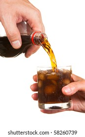 pouring soda into a glass isolated on white background