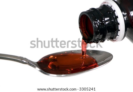 Pouring some cough medicine into a spoon