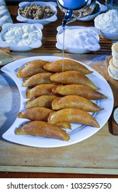 Pouring Syrup on Qatayef, Arabic Sweets with Nuts and Other Ingredients for Ramadan and Eid