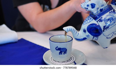 Pouring tea from elephant shaped teapot