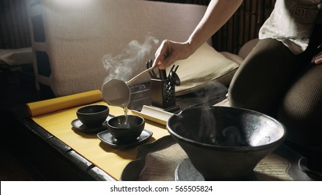 Pouring tea with the help of ladle.Tea ceremony. Brewing tea in the style of the Tang dynasty. A staged ceremony of brewing Chinese tea the original method.
