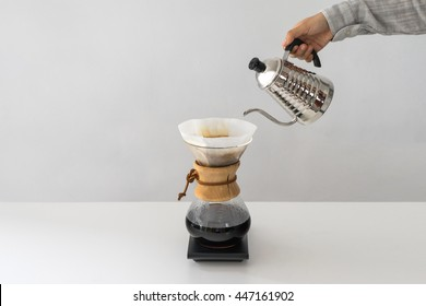 Pouring Water  to the Coffee Pot on White Wall and White Table, Manual Brew, Hand Drip Coffee