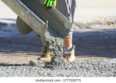 pouring wet concrete while paving a driveway