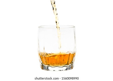 Pouring whiskey or bourbon into the glass. Isolated on white background.