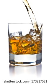 pouring whiskey in glass on white background