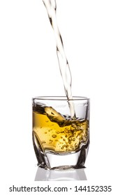 pouring whiskey isolated on white background
