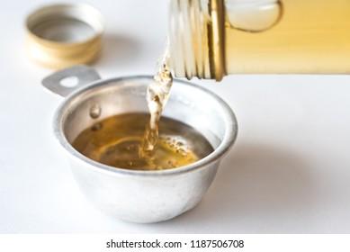 Pouring White Wine Vinegar