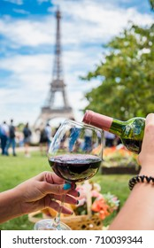 Pouring wine is the big glass at the Trocadero place with the Eiffel tower view in Paris