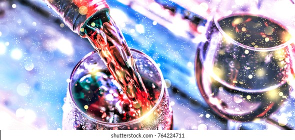 Pouring wine. Christmas wine. Christmas, falling snow, golden snowflakes. New Year