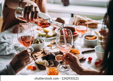 Pouring wine at a dinner party with friends.