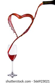 Pouring wine heart romantic shape to elegant glass on white background