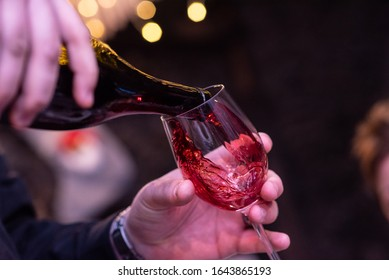 Pouring wine at the table in a restaurant