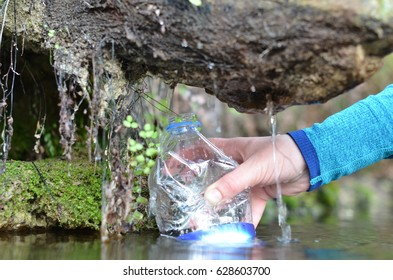 pours water from a spring