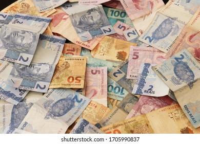 Pouso Alegre/ Minas Gerais/ Brazil- April 15 2020: Brazilian banknotes banknotes with blurred background