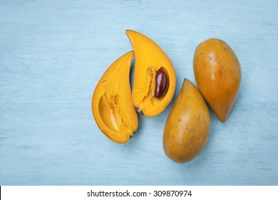 Pouteria Campechiana fruit with space on wooden blue background