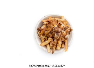 Poutine isolated on white; Gravy on fries.