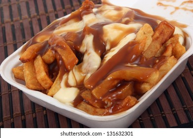poutine : Quebec meal with fries potatoes, gravy and cheese curds