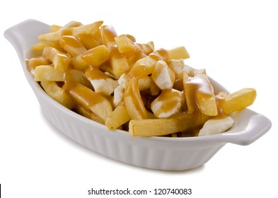 Poutine, traditional fast food in Quebec, Canada. Close-up.