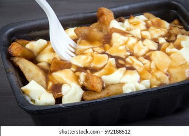 Poutine tray quebec meal with french fries, gravy and cheese curds from a fast food restaurant