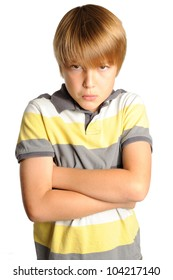 Pouting Young Boy. Nine year old boy with his arms crossed while expressing negative feelings. Isolated on white.