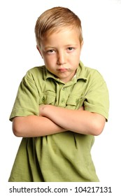 Pouting Young Boy. Seven year-old boy standing with his arms crossed and expressing negative emotions. Isolated on white.