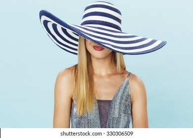 Pouting young lady in summer hat