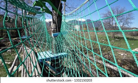 POV at adventure park hanging bridge net
