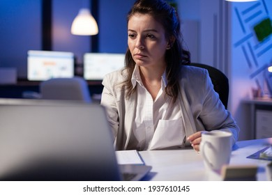 Pov of businesswoman looking in camera during online videocall conference, talking with teamates for rise profit. Manager analysing marketing statistics late at night in business office
