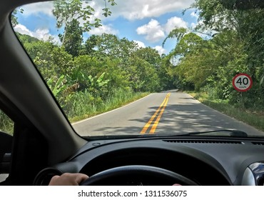 POV of driver single road Brazil 40km limit sign