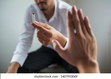 POV Hand making reject or refuse sign for cigarette from friend. Can use for quit smoking or world no tobacco day concept.