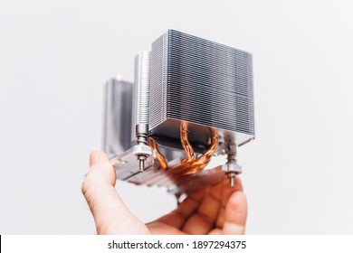 POV male hand holding computer heatsink showing hero object of modern steel cooling device for personal computer workstation