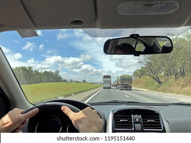 Pov of a man driving a car on the roads of Brazil.