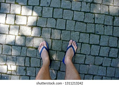 POV man walking a paving stone
