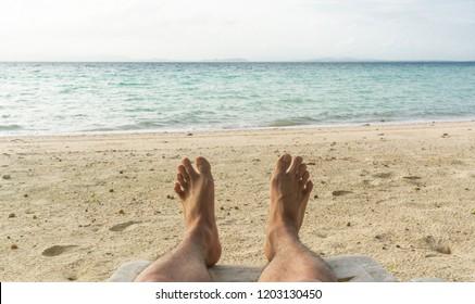 Pov, Men legs on sand beach and sky